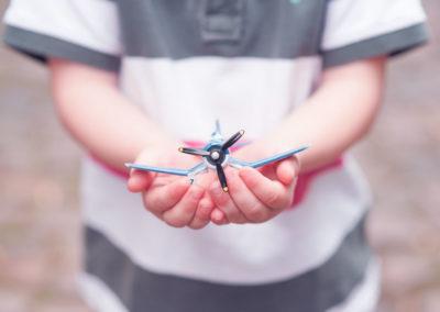 boy holding airplane