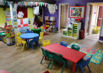 inside of nursery with tables and chairs