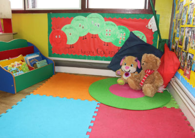 play mat with stuffed teddy bears on top